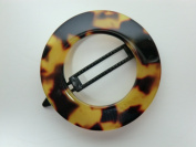 "Charles J. Wahba - Large Round Cut-out Barrette with Manual ""Delrin"" Closure"