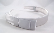 Elegant New Silver Headband with Bow