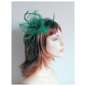 QUALITY BOXED GREEN MESH FLOWER SHAPED HAIR FASCINATOR WITH CENTRED RHINESTONES AND MATCHING FEATHERS FINISHED ON SPRUNG CLIP AND PIN FOR BUTTONHOLE