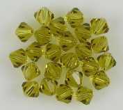 24 6mm. crystal bicone 5301 Lime beads