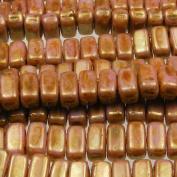 Czechmate 2mm X 6mm Brick Glass Czech Two Hole Bead - Lustre Opaque Rose/Gold Topaz