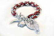 Red Bracelet with Silver Charms