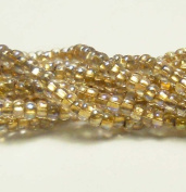 Crystal AB Bronze Lined Czech 6/0 Seed Bead on Loose Strung 6 String Hank Approx 900 Beads