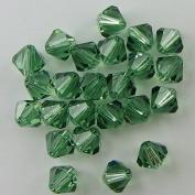 24 6mm. crystal bicone 5301 Erinite beads