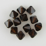 12 8mm. crystal bicone 5301 Mocca beads