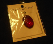 Bead Gallery 32x24mm Ruby Faced Oval Glass Pendant