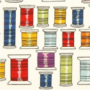 ecru fabric by Alexander Henry with colourful thread spools