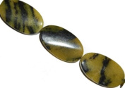 Yellow natural turquoise twisted oval gemstone beads, 36x22mm, sold per 16-inch strand.