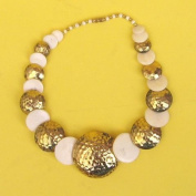 Stylish Necklace of Bone and Hammered Brass Discs in Graduated Sizes