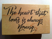 "Phrase Rubber Stamp ""The Heart That Loves Is Always Young."""