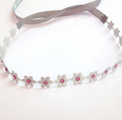 Metallic Silver Flower Wrap with Pink. Rhinestones