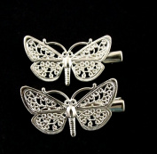 A pair of small butterfly hair clips fillagree style