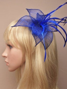Hair Fascinator in Royal Blue sinamay pointed petals and feathers mounted on a clip suitable for weddings, races, prom