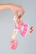 Textile toy angel with heart