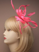 crystal innovation Ref:4313- (neon pink) Large coloured coiled net and feather fascinator on a clear comb.