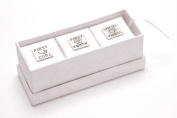 Three miniature keepsake gift boxes in soft white handmade paper finish, nestled in a long oblong box. Each baby box features a pewter design 'First Curl' 'First Tooth' and 'Special Things'. By Metal Planet