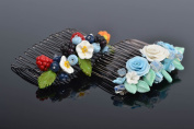 Set of 2 beautiful handmade hair combs with polymer clay flowers and berries
