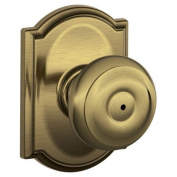 Schlage F40GEO609CAM Antique Brass F-Series Privacy Georgian Door Knobset with the Decorative Camelot Rose F40-GEO-CAM