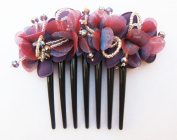 French twist hair comb Ornamented along the top of the heading with Flowers made from fabric