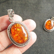 2 Amber Liked Oval with Tibetan Bezel Frame Amber Liked Charms