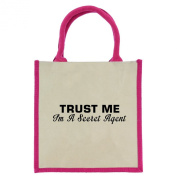 Trust Me I'm a Secret Agent in Black Print Jute Midi Shopping Bag with Pink Handles and Trim
