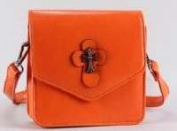 Victoria Leland Designs 82584 Bag-Cross Body Vegan Leather withMetallic Cross Accents - Orange