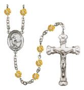 Silver Plate Rosary features 6mm Topaz Fire Polished beads. The Crucifix measures 1 5/8 x 1. The centrepiece features a Guardian Angel/Soccer medal.