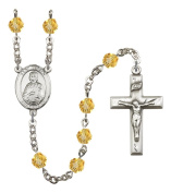 Silver Plate Rosary features 6mm Topaz Fire Polished beads. The Crucifix measures 1 3/8 x 3/4. The centrepiece features a St. Gerald medal.