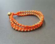 Orange Knot Brass Bracelet