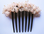 French twist hair comb Ornamented along the top of the heading with Stone Pink