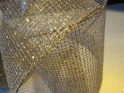 10cm . x 7.6m Platinum wired Designer net Ribbon