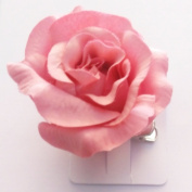 Large pastel coloured fabric rose on a forked clip. Available in cream, pink, lilac, purple, peach and rose.