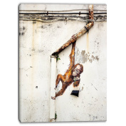 "Designart PT6969-80cm - 100cm Baby Orangutan Hanging From Pipe Street Art"" Canvas Print, Brown, 80cm x 100cm"