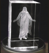 In The Arms of Jesus Night Light or Desk Display Christus in Crystal 7.6cm tall with plug in power supply, rotating LED light base with pure white light. In royal blue gift box.