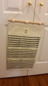 White & blue hanging organiser great for little stuff or underwear, wooden rod with anker print