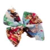 Christmas Puppy Dogs A hair bow from the vintage dressmaker Silly Old Sea Dog. Complete with a clip which can be used to attach to hair or clothes, this pretty accessory has been handmade in the UK