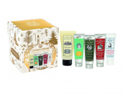 Surprise Gift Set, which includes our bodycare essentials, 2 hand creams, foot cream, body lotion, and shower gel with fresh scents, made in France