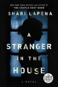 A Stranger in the House [Large Print]
